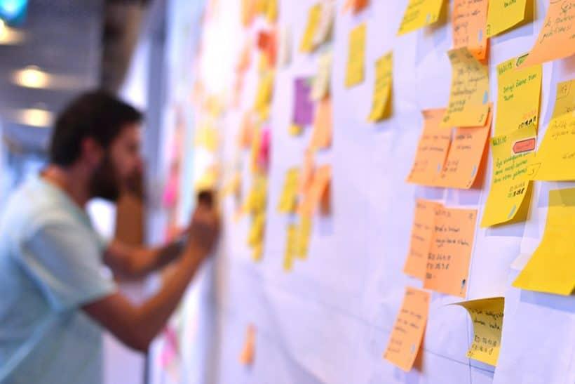 An agile worker updating Kanban board